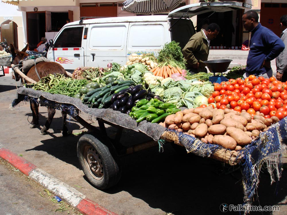 Vegetables and donkey in a market street