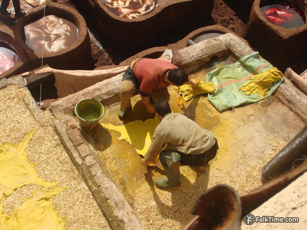 Workers prepare hides