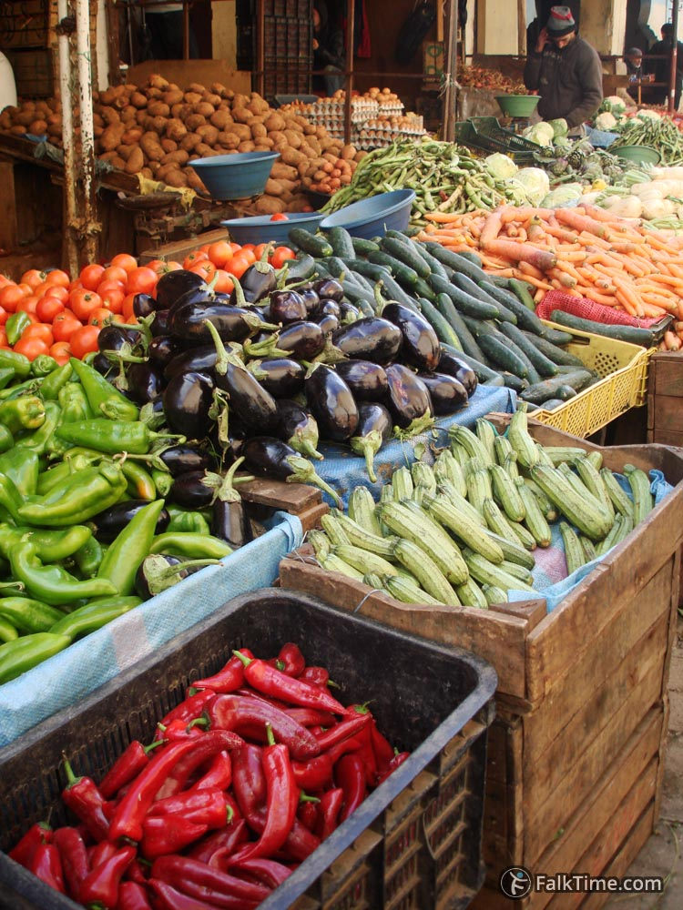 Eggplants, pepper, courgettes in a market
