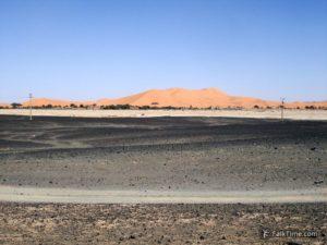 Black stony desert and orange dunes